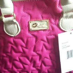"""Luv Betsey Johnson Mini Dome Satchel Luv Betsey Johnson Mini Dome Satchel, one side fushia color with quilted embroidered stars, the other side bone colored. Measurements L 9"""" H 8"""" D 4.5"""" with adjustable 52"""" bone colored strap, and 5"""" bone colored double handle drop, top zipper closure, Gold tone hardware. Betsey Johnson Bags Mini Bags"""