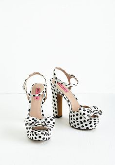 A Little Picnic-Me-Up Heel. Perk up your afternoon with a spontaneous picnic - and the enviously charming style of these black and white pumps by Betsey Johnson. #white #modcloth