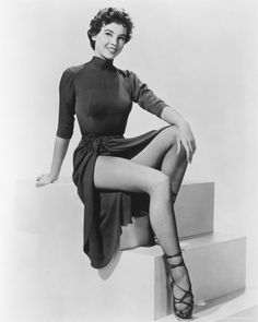 Leslie Claire Margaret Caron (b. 1July 1931): French film actress, dancer (45 films between 1951~2003).  Best known for films An American in Paris (1951), Lili (1953), Daddy Long Legs (1955), Gigi (1958),  Fanny (1961), The L-Shaped Room (1962), and Father Goose (1964). She is one of the few dancers or actresses to have danced with all Gene Kelly, Fred Astaire, Mikhail Baryshnikov, and Rudolf Nureyev. ~Wikipedia  (I must have watched Gigi a hundred times!)