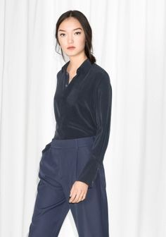 Made from luscious silk, this wardrobe essential has a straight, slightly loose fit with a buttoned front and prominent cuffs.