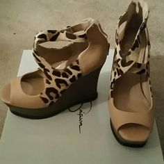 Jessica Simpson Nude and Leopard Wedge Shoes Natural/Nude and leopard open toe wedge shoe...wooden heel and zipper closure on the back/heel...leopard section is made of mohair-like material...box available upon request Jessica Simpson Shoes Wedges