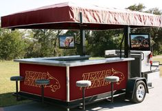 I would LOVE one of these for tailgating!!!!!! Make the front a grill, coolers under the counter :)