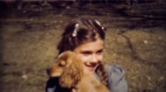 1949: Girl pigtails holds happy brown spaniel breed puppy. DENVER, COLORADO. http://www.pond5.com/stock-footage/58862302?ref=StockFilm keywords:Child, outside, summer, spring, fun, show off, cute, enjoyment, love, new puppy, dog, pet, family, breed, sweet, caring, braids, friends, sister, holding, happy, 1949, Girl, pigtails, holds, brown, spaniel, puppy, 1960s, 8mm, film, old, tv, commercial, past, home movie, vintage, style, retro, rare, unique, archive, nostalgia, sentimental, memories…