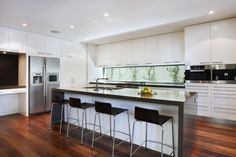 Mink stone benchtop and white cabinets