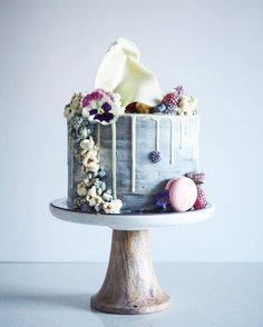 Simple, geometric marbled cake w/ fruit or structured flowers.