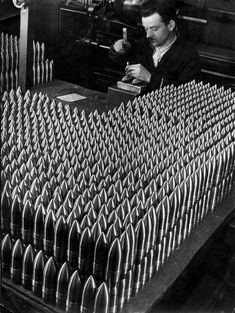 Margaret-Bourke-White, Czech worker stamping 15-centimeter shells in the Skoda munitions factory, Czechoslovakia, 1938