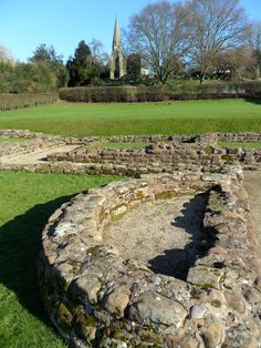 Ruins of the Roman Settlement called Letocetum at Wall, near Lichfield, built around 50 AD and abandoned around 500 AD, St John's Parish Church in the distance. Staffordshire, England.