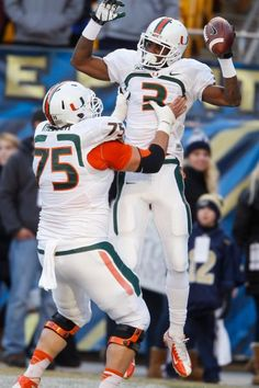 Miami wide receiver Stacy Coley (3) celebrates with offensive linesman Jared Wheeler (75) after making his second touchdown catch and run. (Keith Srakocic/AP)