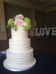 Buttercream and fresh flowers wedding cake