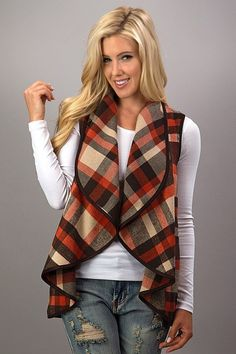 These plaid vestsare so perfect to throw on and go! They are an absolute must have for Fall and Winter! This vest features a waterfall style, open front, & faux leather piping with side pockets. Small fits size 0-2/4 Medium fits size 6/8 Large fits size 10/12 #JessLeaBoutique