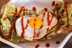 The best avocado toast with a fried egg, capers and siracha at Happy + Hale via Bites of Bull City | Photo: Tommie Watson Photography