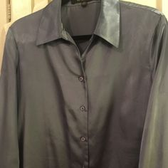 Beautiful Silky Silvery Blue Blouse Looks and feels like silk but is 100% polyester. Very soft. Hard to photograph bc of sheen but it's in good shape. Fits true to size 12. Great classic shirt for working professional. No stains or rips. Kasper Tops Blouses