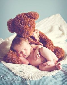 Newborn baby photo with teddy