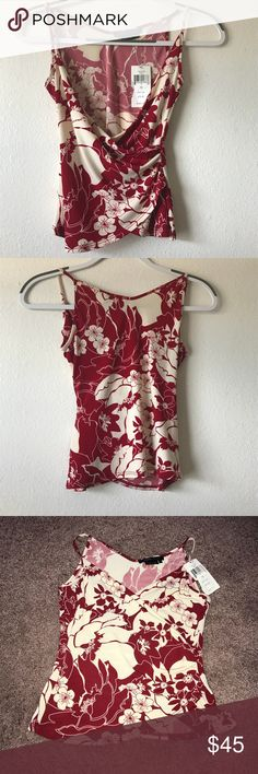 BCBG Max Azria spaghetti strap top Beautiful top with a floral print in size XS.  ✨Excellent condition  ✨Please feel free to ask questions BCBGMaxAzria Tops