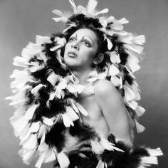 A photo of Holly Woodlawn in Holly Woodlawn was a transgender Puerto Rican actress and Warhol superstar. This photo represents avant garde art with her feathers,pose, and eyebrows. Photo by Jack Mitchell/Getty images Glam Rock, Puerto Rican Actresses, Holly Woodlawn, Superstar, Joe Dallesandro, Candy Darling, 70s Makeup, Warhol, Film