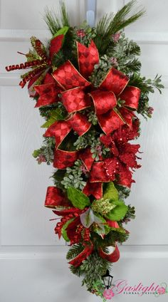 Elegant Christmas Wreath with glitter amaryllis and poinsettia stems by Gaslight Floral Design.  GaslightFloralDesign.com