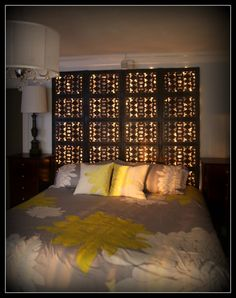 DIY Illuminated Headboard - Re-purposed wooden room divider is illuminated with white Christmas lights and converted into a headboard!
