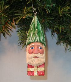 Hey, I found this really awesome Etsy listing at https://www.etsy.com/listing/190886682/carved-santa-ornament-with-tree-hat-wood