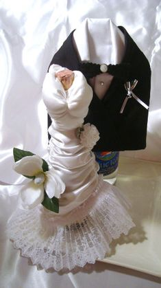 Bride and groom wine bottle covers on Instructables.  Check this cool idea out!