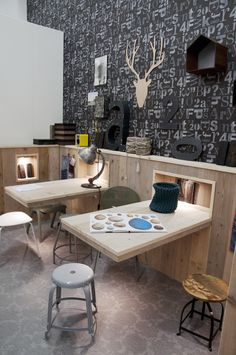 "Fantastic craft room / workspace...not the kind of workspace I need but I do like the wallpaper & having some ""deer"" outdoor decor mixed in..."
