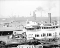 Vancouver in 1915 - Passengers boarding a North Vancouver ferry. Archives# SGN 1124.