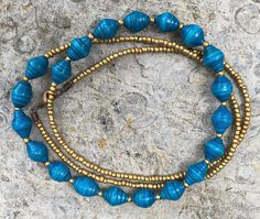 Blue paper bead necklace with gold accent