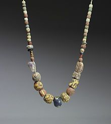 A 6th-7th century necklace of glass and ceramic beads with a central amethyst bead. Similar necklaces have been found in the graves of Frankish women in the Rhineland.