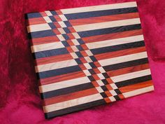 Argyle - Face grained, Rock Maple, Padauk and Wenge cutting board. $90.00, via Etsy.