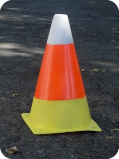 Giant Candy Corn: there are some cones on our sidewalk: maybe the water district guys will forget they're here!