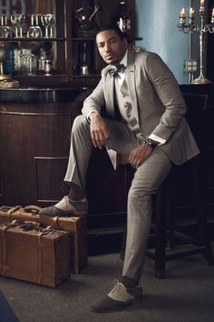 Laz Alonzo in a three-piece suit from Alexander Nash, shirt from BDG, bowtie from Ike Behar, pocket square from Kiton, and jewelry by Maddaloni Jewelers (for FUZION Mag)