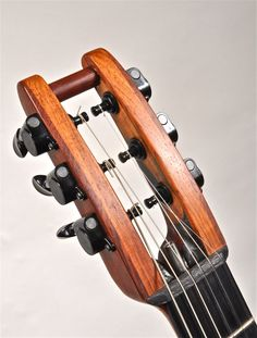 Tom Curneen designed open-frame headstock in Honduras rosewood and carbon fiber