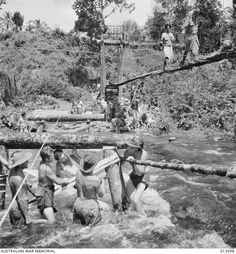 New Guinea Kokoda 1942. Engineers building a bridge - one of the many that will be necessary along the track from Kokoda to Buna. Photo Credit: AWM.