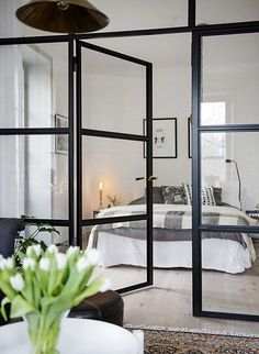 Love iron doors, light wood floors.