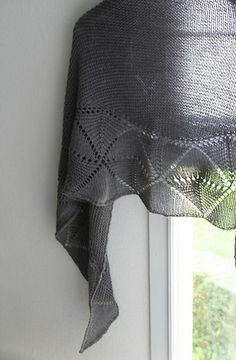 Swinging Triangles is a simple but graphic lace shawl, knitted in two sections. The changes between garter and stockinette make the triangles swing!