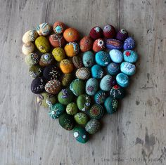 Lisa Jordon from lilfishstudios creates beautiful embroidered stones.  Combining two of my favourites things, rocks and embroidery.