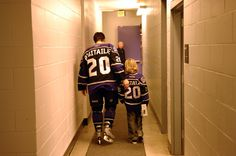 Robitaille walks down the tunnel with his son after his final home game as a Los Angeles King, April 2006