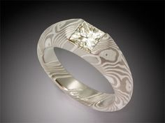 Mokume integral half bezel ring 5mm wide in etched mokume of 14K palladium white gold and sterling silver with princess cut diamond