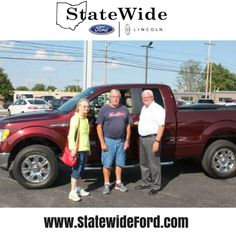 Rodger and Barbara Rice taking delivery of their Ford F-150 from Randy Custer. Thank you for your business!