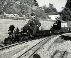 92. Here's Ward driving a miniature train with his passenger ...