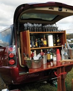 Tailgating Goes Upscale: Don't think I will ever need a full bar at a tailgate, but the wood-work table and shelf looks to be an easy build or recycle. Love the idea for a portable spread! Tailgate Bar, Football Tailgate, Football Season, Tailgating Ideas, Tailgate Parties, Fall Football, Tailgate Drinks, Picnic Parties, Football Parties