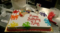 1/2 sheet cake with Arty paint splatter theme. Fondant paint splatters with an easel and a painter's pallet and brush.