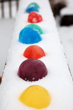 Colored snow with frozen balloons filled with food coloring and water