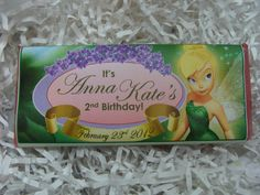 Faith...trust...and of course, Pixie Dust becomes the theme at your little girl's Tinkerbell-themed Birthday Party with these dazzling candy bars! Tinkerbell with her glittery wings, poses next to the Birthday Girl's Name and Age in an oval banner on the front, while glittered pixie dust surrounds her. Whimsical nutritional information entertains the back of the candy bar while the enchanting fairy peaks through leaves. This enchanting candy bar is sure to be a hit at your little girl's…