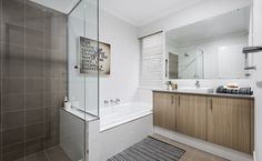 The main bathroom is spacious with semi-inset basin, Caesarstone benchtops and bath