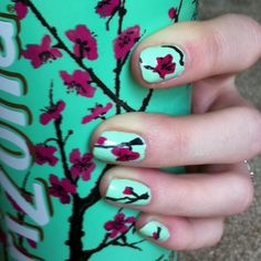 I just did this :D I was drinking arizona tea and I noticed that the nail polish was the same colour so bright idea I painted flowers :D (I cheated a little. The black is sharpie :3 couldn't find my nail pen)