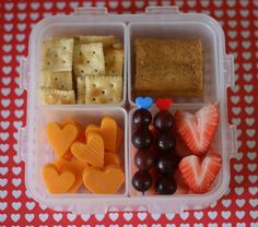 mini crackers, cereal bar, cheese, grapes, strawberries snack time