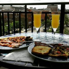 Sunday brunch on the patio. Sausage tomato asparagus frittata with bacon and mimosas #sundayfunday #brunch #downtownliving #downtowna2 #a2
