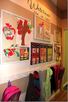 mud room, hallway, wall of garage, each child has a bulletin board, hooks for jackets and back packs below.