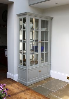 One of a Pair of painted glazed display cabinets,made from tulipwood, handpainted in Farrow and Ball's 'Lamproom Grey', The cabinets were fitted with antiqued mirror backs, solid shelves and recessed LED strip lighting.  #cabinets