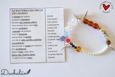 La historia mas bella del mundo. Pulsera elastica con cuentas de cristal y metal con 4 dijes: estrella, cruz, corazón y pez.  Handmade by Duvhaliin